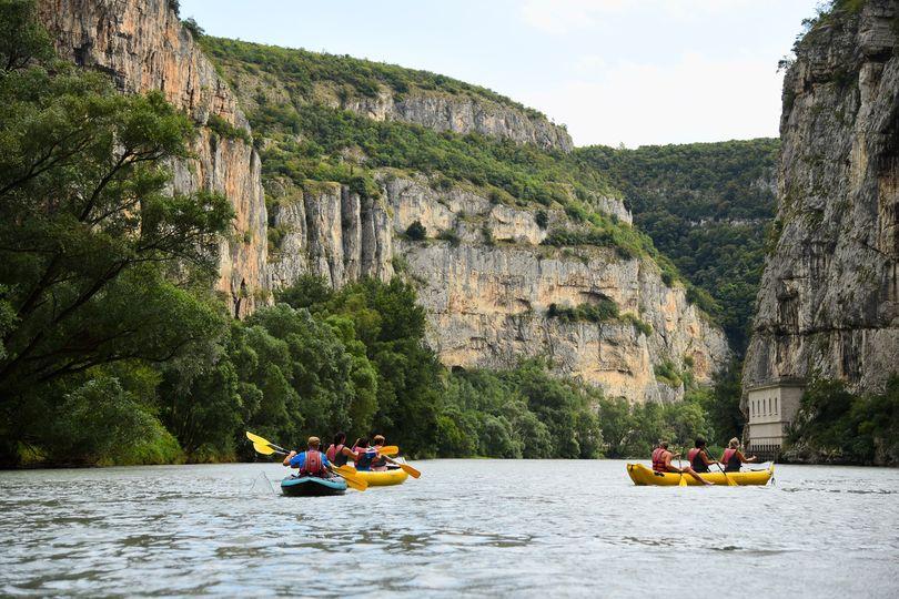 Experience the unique thrill of canoeing through the Chiusa di Ceraino canyon! ...